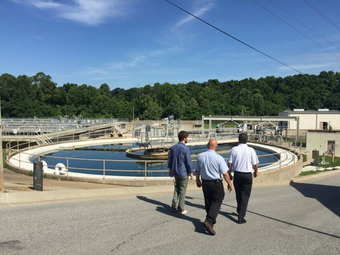 Men walking at the Wastewater Treatment Plant