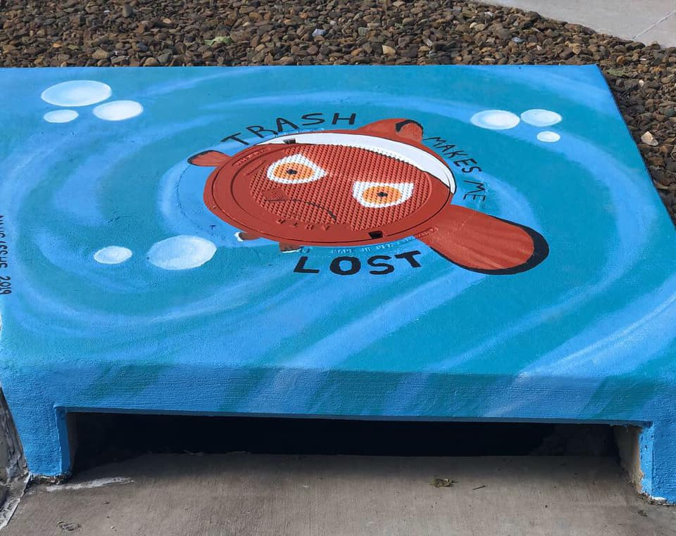 mural on storm drain of an angry-looking clown fish