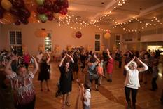 Attendees dancing to YMCA at the Mother/Son Dance